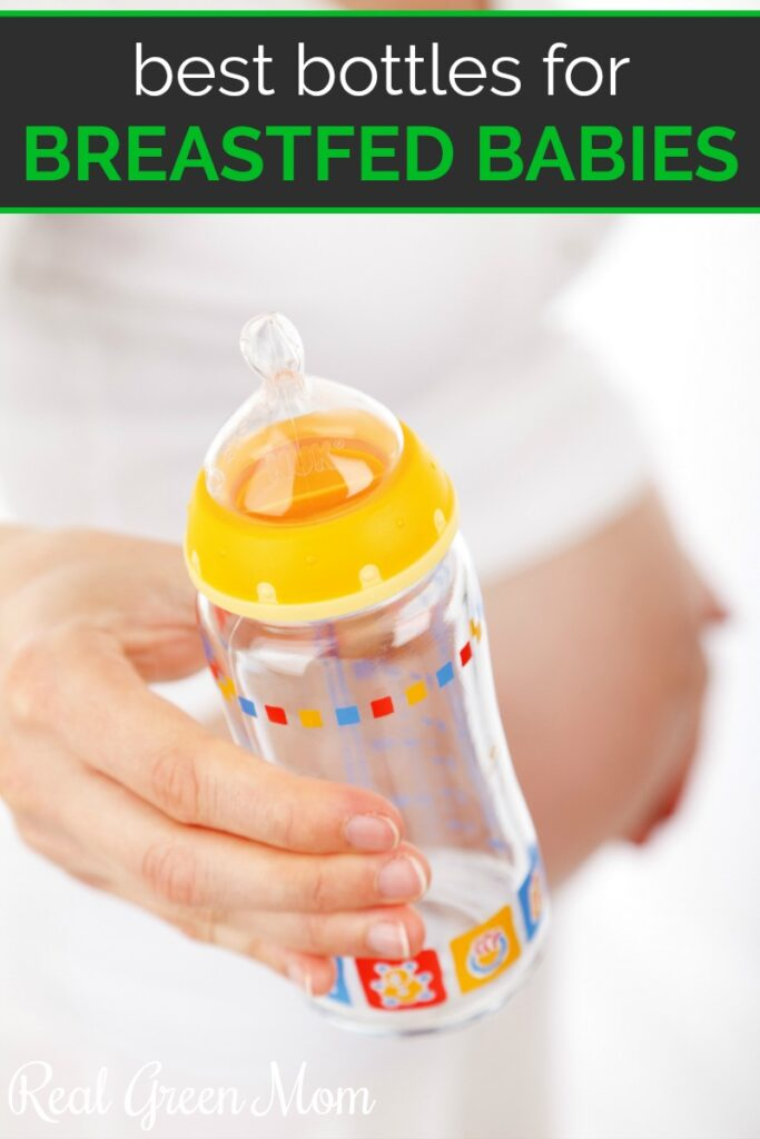 Pregnant woman wearing white and holding baby bottle