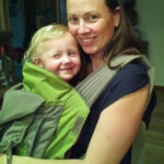 Chrystal wearing Kaylee in the Onya Baby carrier in the front carry position