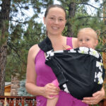 Chrystal wearing Kaylee in the Balboa Baby adjustable sling