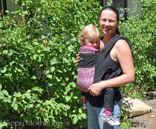 Chrystal wearing Kaylee in the front carry position in a Boba soft structured baby carrier