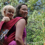 Chrystal wearing Kaylee in a Catbird Baby Mei Tai Carrier