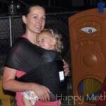 Chrystal wearing Kaylee in the Baby K'tan baby wrap