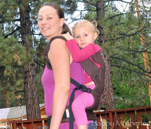 Chrystal carrying Kaylee in the back carry position with the Beco Gemini baby carrier