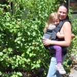 Chrystal wearing Zoe in the ErgoBaby Performance Baby Carrier