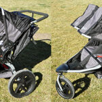 Large sunshade folded down on the BOB Revolution Duallie jogging stroller