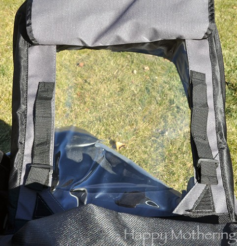 Sunshade has a clear window to check on baby in the stroller