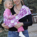 Chrystal wearing Kaylee in a Hotsling AP sling baby carrier