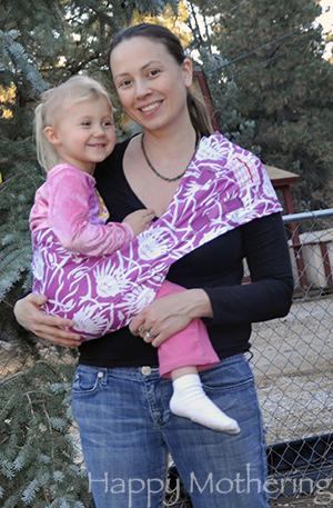 Chrystal wearing Kaylee in a Hotsling AP sling baby carrier