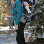 Chrystal wearing Kaylee in a Kelty backpack
