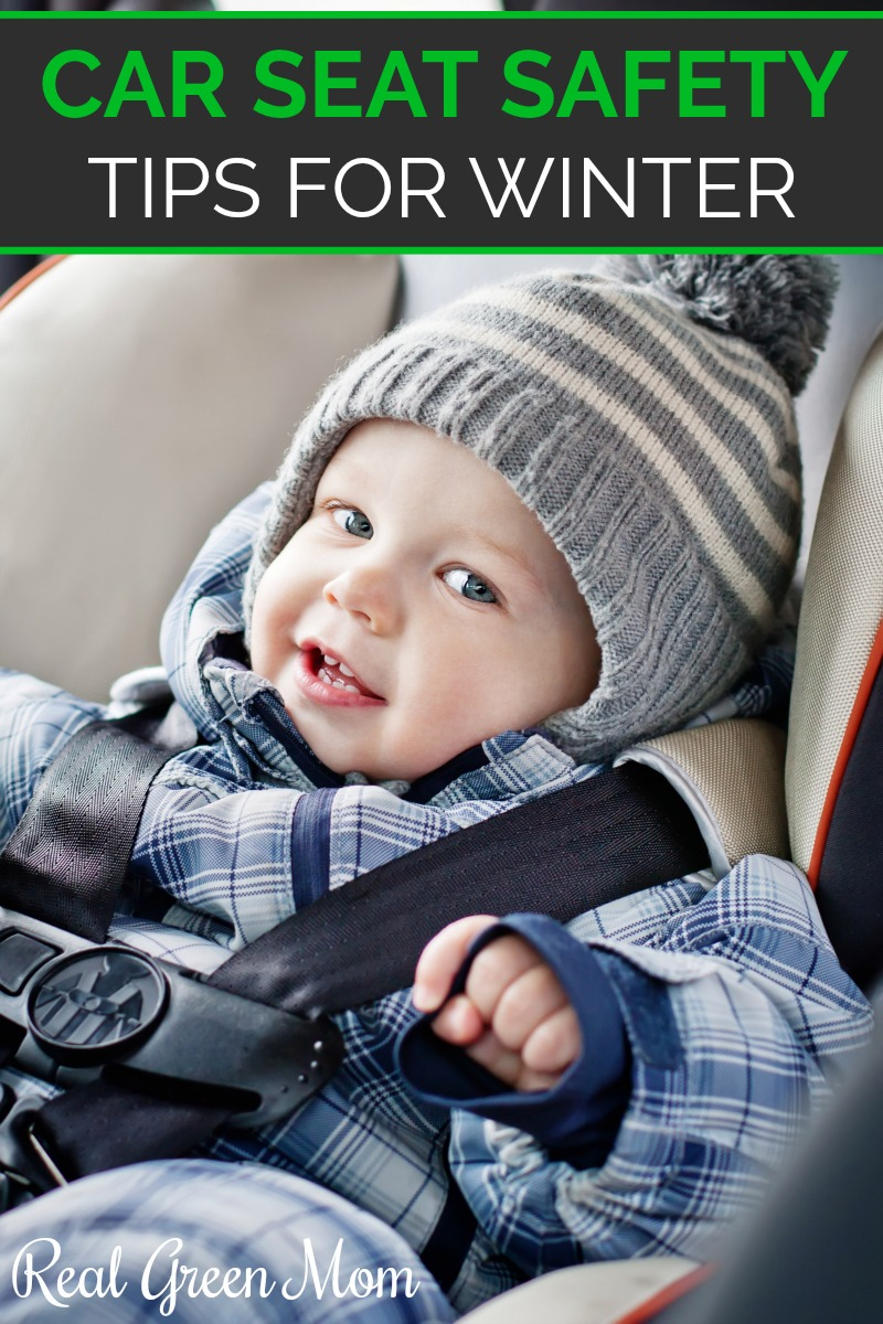 Baby boy bundled up in way too many coats to be strapped into a car seat