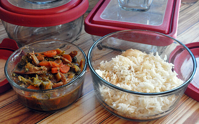 Four glass food storage containers with lids