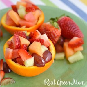 Close up of homemade fruit cups on a green ceramic plate