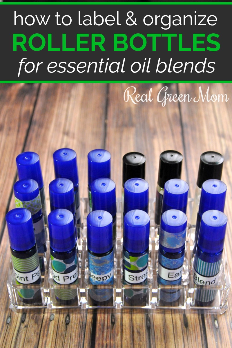 Essential oil blends in roller bottles labeled and kept in a plastic lipstick container for organization