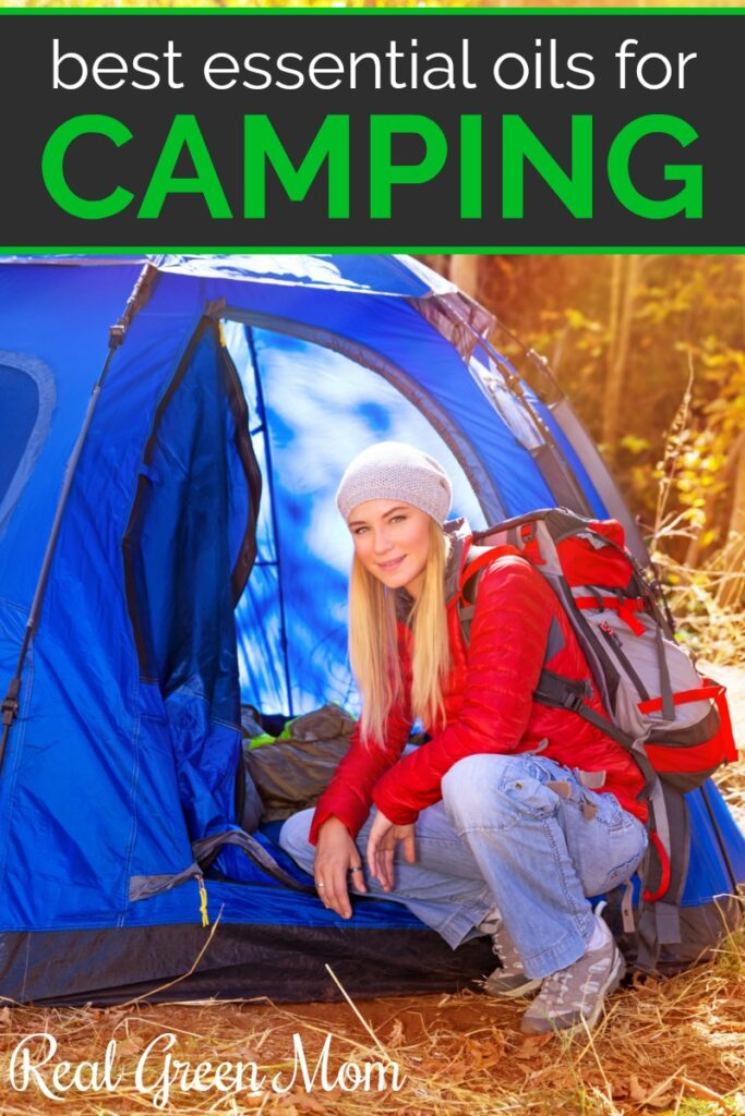 Young blond woman with red backpack in front of blue tent