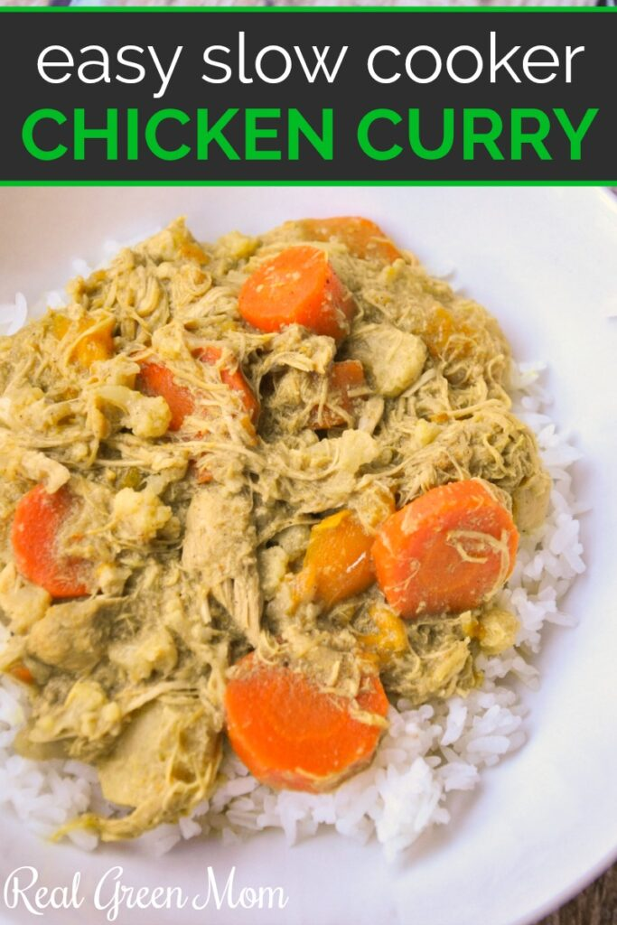 Chicken curry with carrots served over white rice in a white bowl