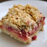 Pomegranate apple pie bar on white dessert plate