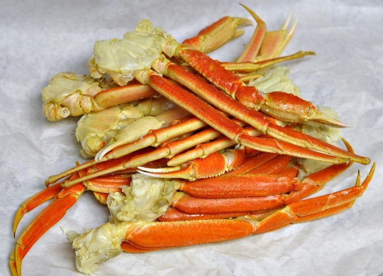 Alaska snow crab legs on butcher paper