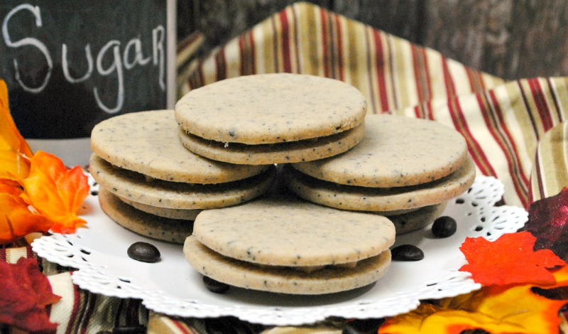 Four homemade pumpkin spice sandwich cookies