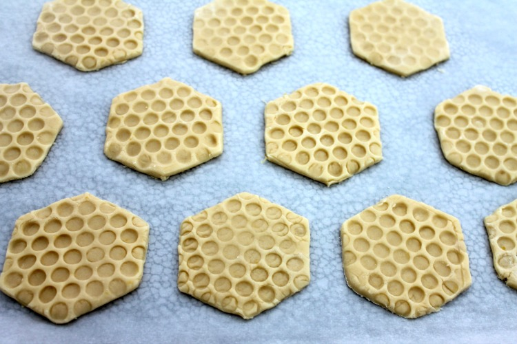 Honeycomb shortbread cookies on a baking sheet after being chilled
