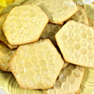 Close up of homemade honeycomb shortbread cookies on a yellow serving plate
