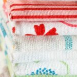 Stack of folded cloth napkins n various colors and patterns
