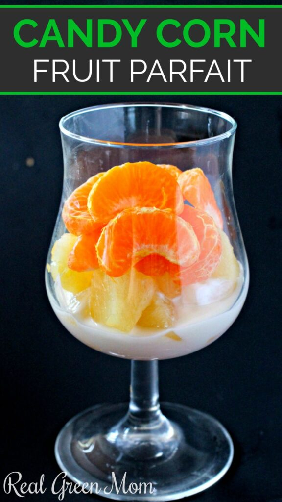 Candy corn fruit parfait made in clear glass cup with stem