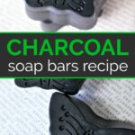 Four butterfly shaped melt and pour charcoal soap bars on newsprint
