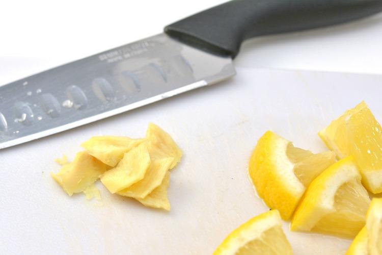 Chopped ginger next to lemon slices