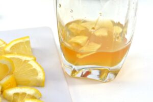 Ginger added to glass with honey and apple cider vinegar