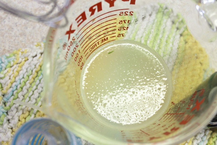 Aloe, essential oils and water in a glass measuring cup
