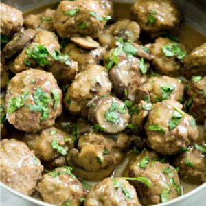 Close up of pan of Salisbury meatballs with mushrooms