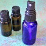 Blue spray bottle and two essential oil bottles